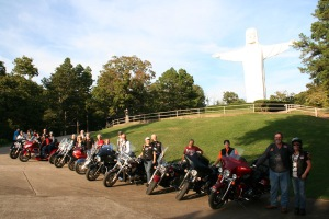 Bikers pose for a photo at the Christ of the Ozarks on the grounds of The Great Passion Play (Eureka Springs, Arkansas).